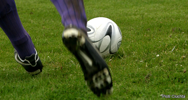 How far does a footballer run during a match?